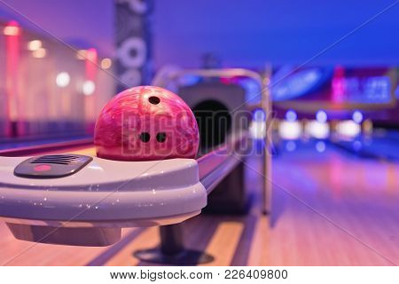 Young Asian Teennager Holding Bowling Ball,bowling Shoes And Ball For Bowling Game,relaxing Concept.