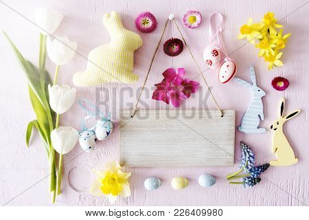 Brown Wooden Sign With Copy Space For Advertisement. Pink Easter Flat Lay With Decoration Like Easte