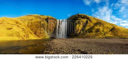 Panorama Of The Famous Skogafoss Waterfall In Southern Iceland. Long Exposure.