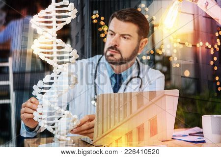 Dna Research. Clever Experienced Qualified Doctor Thinking About An Important Genetic Research While