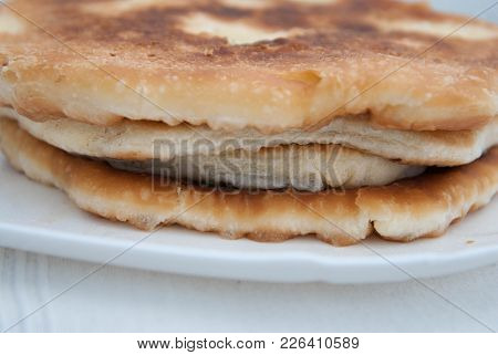 Traditional Russian Pasties Circle Pie With Cheese. Close Up Cheese Pie.