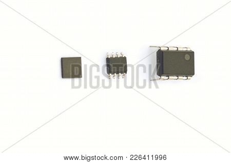 Tree Microchips Isolated On White Background. Discrete Components Packaging Evolution.