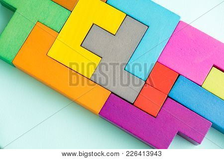 Different Colorful Shapes Wooden Blocks On Beige Background, Flat Lay. Geometric Shapes In Different