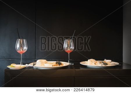 Remaining Meal On Black Table
