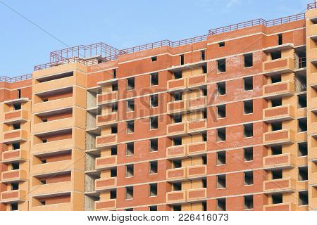 Construction Of An Apartment Building Against The Blue Sky