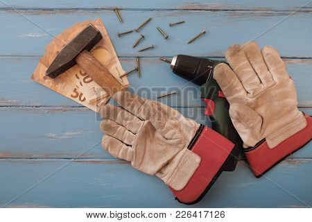 Handyman Tools On Blue Painted Boards With 50 Euro Bills