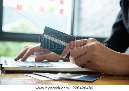 Asian Young Business Hands Holding Credit Card And Using Laptop Smart Phone Online Shopping Website,