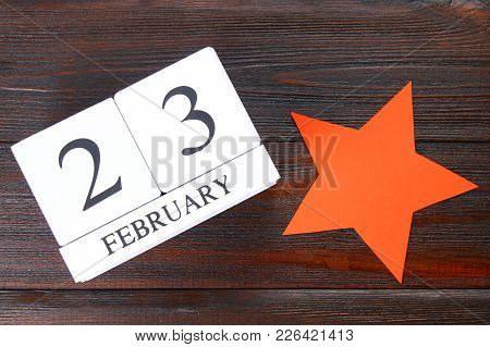 White Wooden Perpetual Calendar With The Date Of February 23 On A Wooden Table. Defender Of The Fath