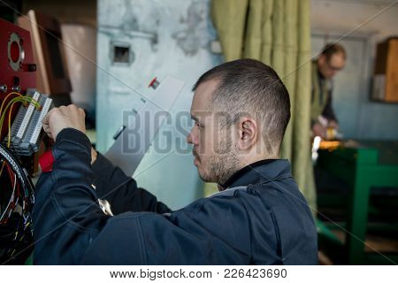 Workers On Plant - Electrician Engineer During Work, Close Up