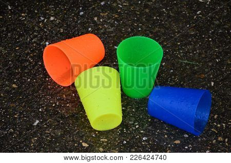 The Colorful Plastic Cups In The Rain