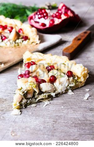 Puff Pastry Pie With Fish Cod Fillet, Spinach, Dill, Pomegranate Seeds And Cream Cheese, Selective F