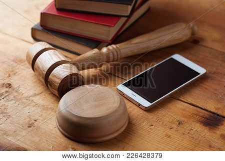 2913014 Smartphone, The Judge's Gavel On Wooden Background.