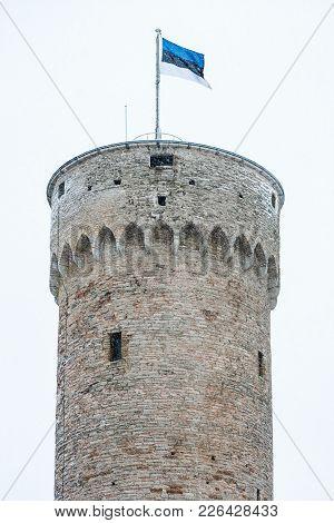 Herman Tower With Estonian Flag During A Snowfall. Tallinn, Estonia, Europe
