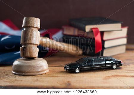 Judge Hammer And A Toy Car On A Wooden Table. American Legal Practice. Symbol Of Law, Justice And Au