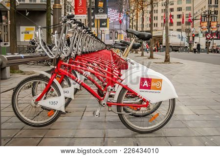 Antwerp, Belgium. January 26, 2018. Bicycles Lined Up At The Antwerp Velo Bike Rental Station At The