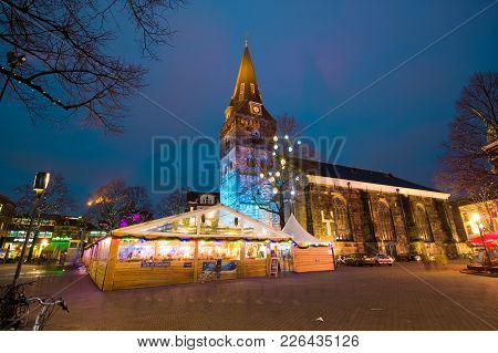 Enschede, The Netherlands - Dec 22, 2017: A Skating Rink Near The Church Downtown During Christmas T