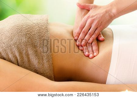 Macro Close Up Of Kinesiologist Applying Pressure On Stomach.detail Of Hands Massaging Belly.
