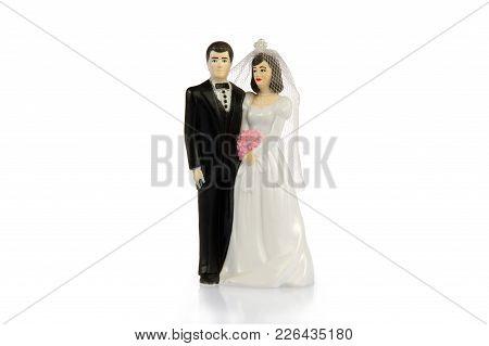 A Plastic Figurine Of A Married Couple