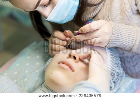 A Young Girl Increases Eyelashes In A Beauty Salon.