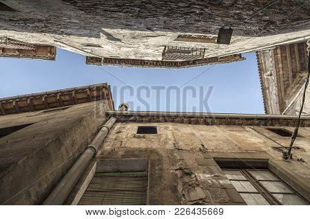 Ancient Facade Buildings Seen From Below In A Street Of Vic, Osona Comarca Regio, Province Barcelona