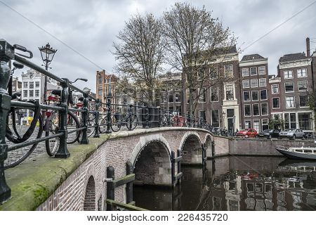 Amsterdam,netherlands-november 9,2011: City View, Typical Dutch Houses, Bridge And Canal.