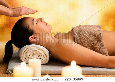 Close Up Portrait Of Woman At Spiritual Enlightenment Reiki Therapy.therapist With Hands Above Head