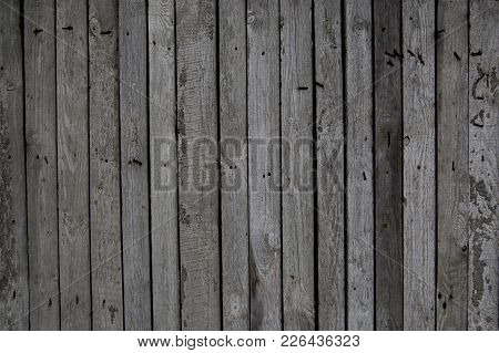 Dark Old Wooden Fence. Wood Palisade Background. Planks Texture