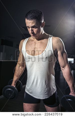 Dramatic Image Of A Fit Man Lifting Weights, Dumbell Exercise