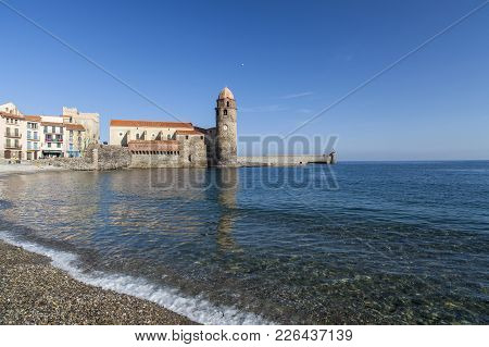 Collioure,france-november 30,2011: Mediterranean Beach And Tower Church Ancient Building In French V