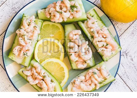 Small Bay Shrimp In Hollowed Out English Cucumbers With Lemon Slices And Sprinkled With Fresh Dill