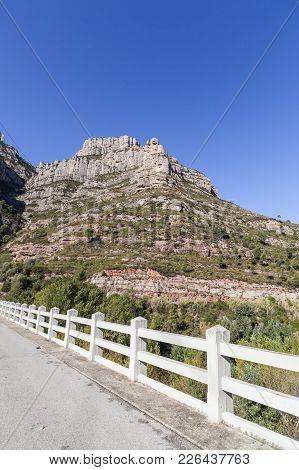 Rock Formations And Bridge, Landscape View, Mountain Peaks Of Montserrat, Massif Near To Barcelona,