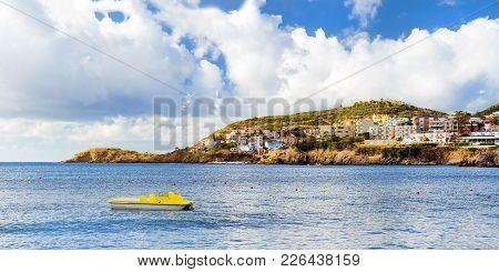 Sunny Sandy Livadi Beach In Sea Bay Of Resort Village Bali. Water Catamaran Parked Near The Shore. V