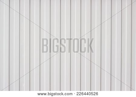 Texture Of The Corrugated Sheet Metal Fence. Background