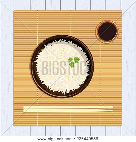 Rice In Ceramic Bowl With Chopsticks And Parsley Green Twig And Sause. Kitchen Bamboo Mat On Distres