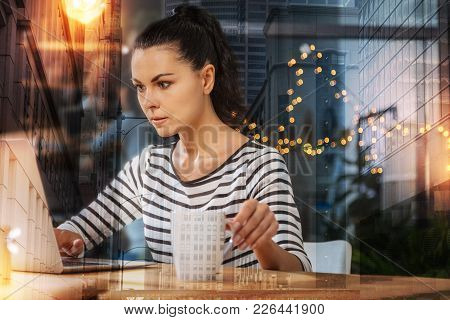 Responsible Employee. Clever Experienced Employee Sitting In Front Of A Modern Laptop With A Cup Of