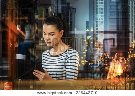 Concentrated Woman. Quiet Attentive Young Woman Reading The Latest News On The Screen Of Her Modern