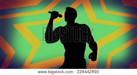 Rock Star Performing with Microphone on Abstract Background
