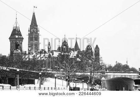 Black And White Picture Of The Canadian Parlement In Ottawa With Snow On The Roof.