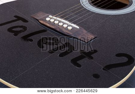 Dust On The Black Guitar. The Inscription Talent. Close Up