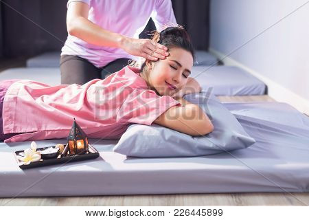 Thai Massage To Happy Asian Woman