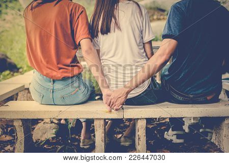 Boyfriend And Another Woman Grab Hands From Behind Together Without Sight Of His Girlfriend.. Paramo