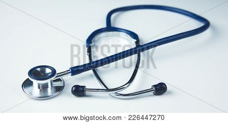 Close Up Medical Stethoscope On A White Background.
