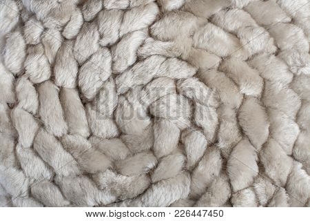 Spiral Pattern Of Knitted Natural Sheep Fur Fabric.
