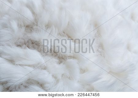 Close-up White Pattern Of Structure Of Cloth Knitting From Yarn And Natural Rabbit Fur.