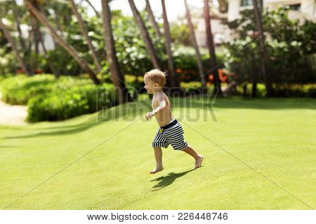 Picture of a two year old boy on vacations at beach