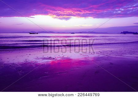 Beach With Beautiful Twilight Sky In Purple And Red.