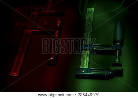 Joiner Or Carpenter Clamps. Light Effect. Close-up.