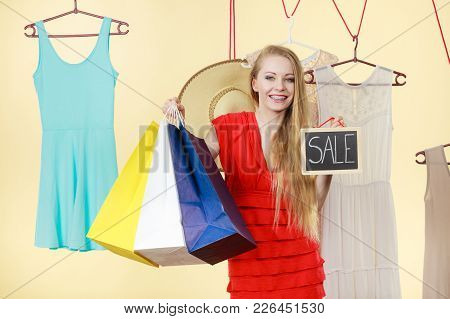 Woman In Shop Picking Summer Clothes, Making Perfect Outfit, Holding Board With Text Sale. Fashion,