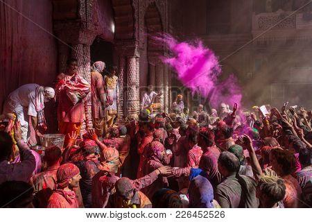 Vrindavan, India - March 22, 2016: Holi celebration in the Hindu Banke Bihare temple in Vrindavan, Uttar Pradesh, India.