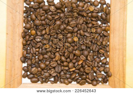 Wooden Photo Frame Filled With Coffee Beans, Top View, Close Up, Copy Space